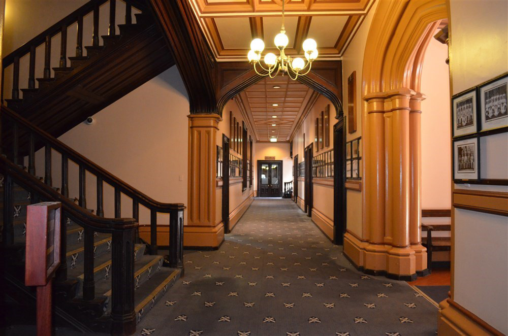 Main Building of the College, looking down the Main Hallway towards the Reading Room. On left, stairs up to the Chapel.